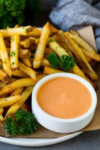 A cup of fry sauce served with homemade french fries.