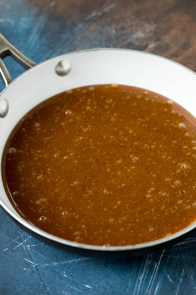A pan of cooked ham glaze.