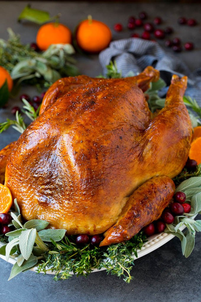 How to cook a turkey with a baked turkey on a serving platter.