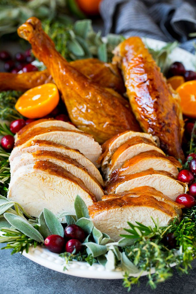 How to cook a turkey with sliced and carved turkey on a platter.