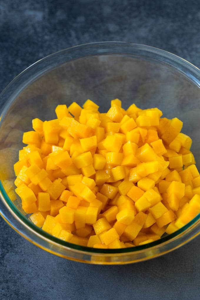 A bowl of diced mango.