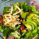 Mexican salad with lettuce, corn, beans and tomato, tossed in a lime dressing.