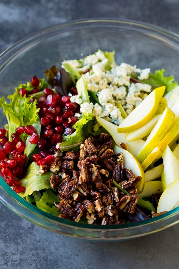 Lettuce with sliced pears, blue cheese and pecans on top.
