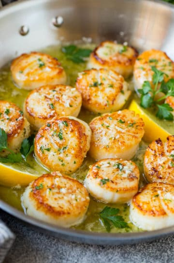 Seared scallops in a lemon garlic sauce with fresh parsley.