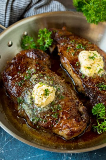 Sirloin steak topped with garlic butter and parsley.