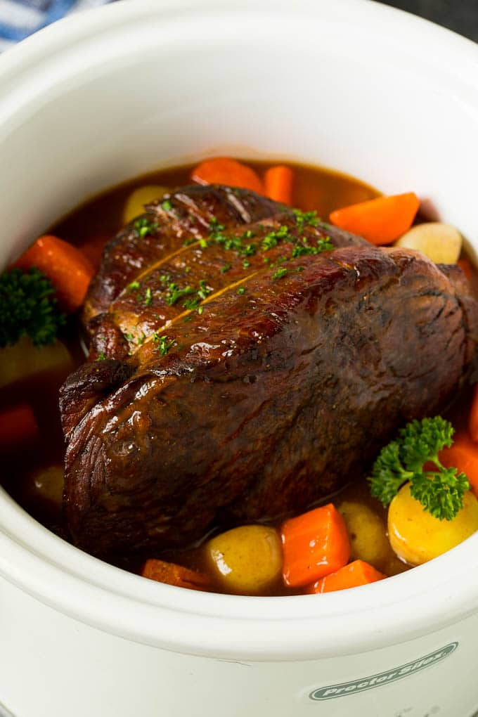 Slow cooker pot roast with carrots, potatoes and gravy.