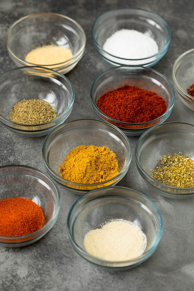 Assorted spices in small bowls.