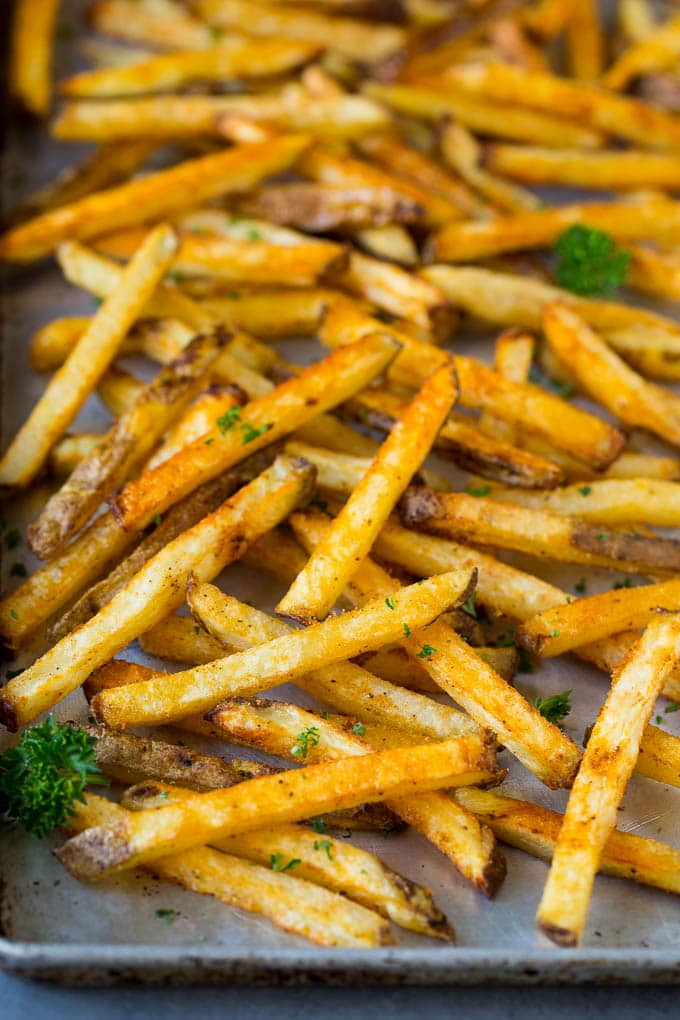Baked french fries on a sheet pan.