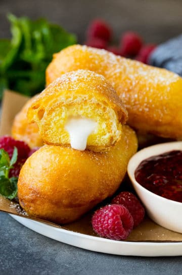 A plate of fried Twinkies served with raspberry sauce.