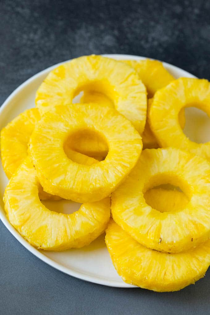 Slices of pineapple on a plate.