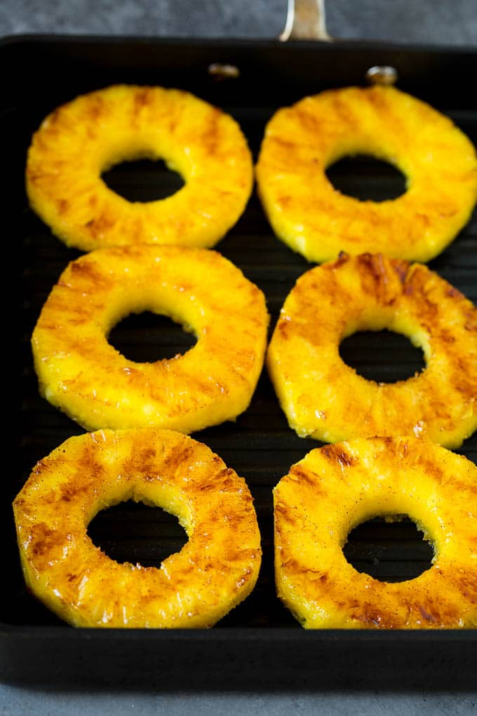Cooked pineapple on a grill pan.