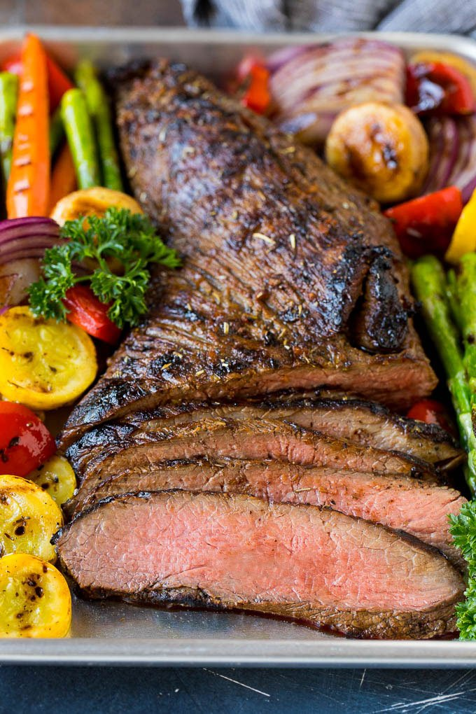 Meat cooked in tri tip marinade sliced and served with grilled vegetables.