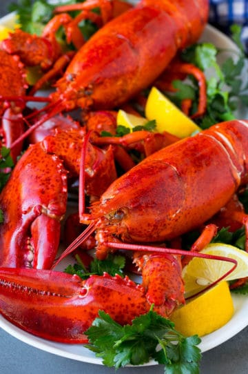 How to cook a lobster with boiled lobsters on a serving platter.