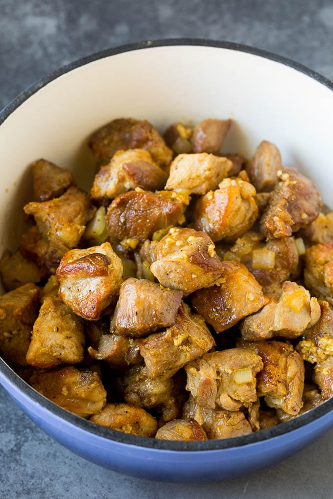 Cubes of pork cooked to a golden brown.