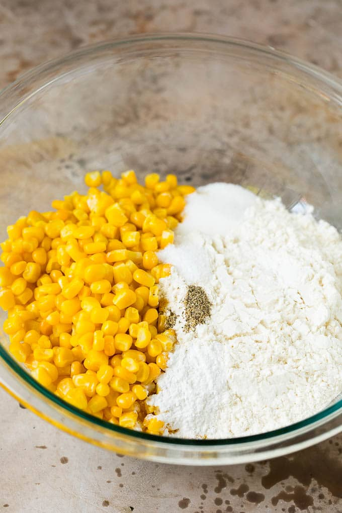 Flour, corn and seasonings in a mixing bowl.