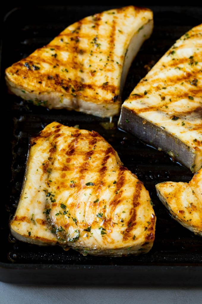Swordfish steaks cooked on a grill pan.
