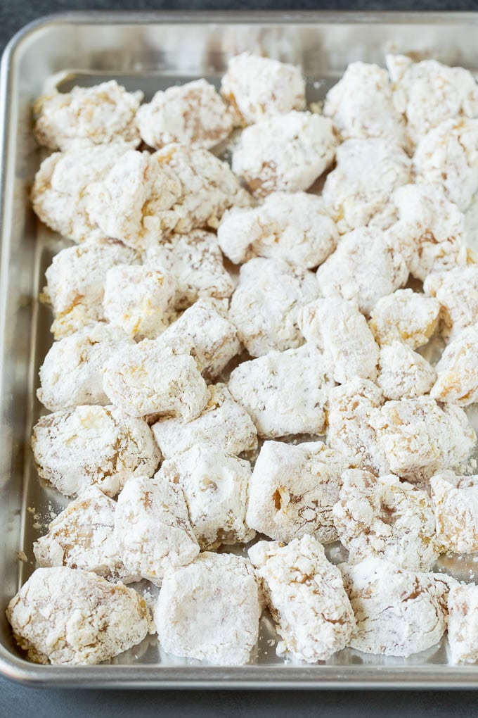 Chicken pieces coated in corn starch and flour.