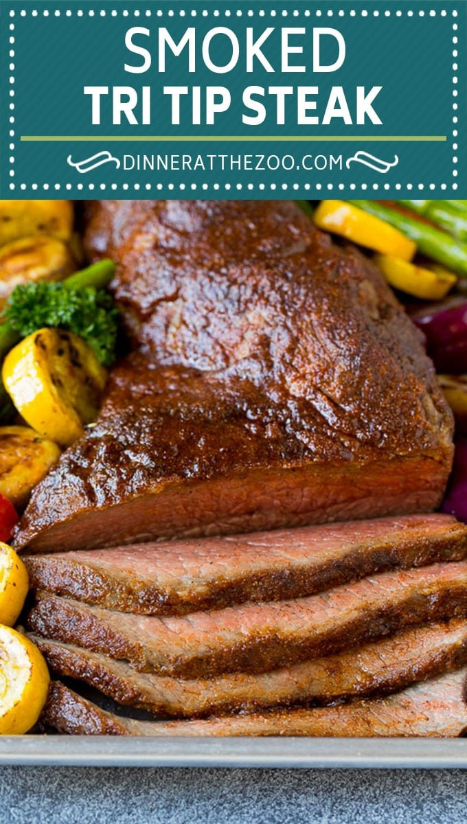 Smoked tri tip is coated in a homemade spice rub then slow smoked to tender and juicy perfection. #beef #dinneratthezoo