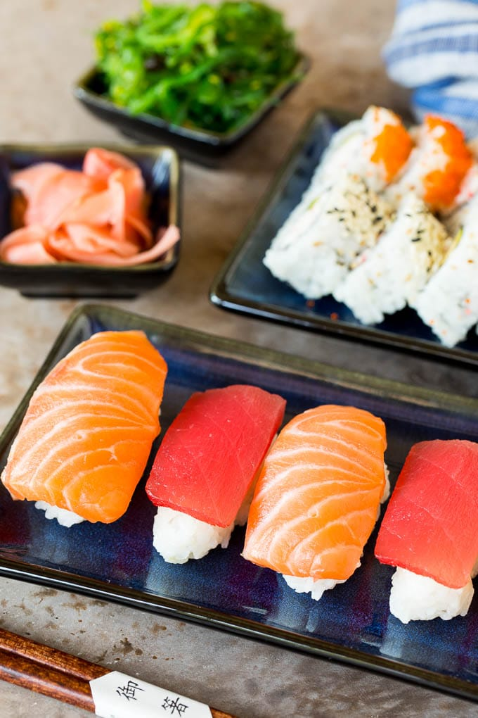 Sushi rice with fish on top and in California rolls.