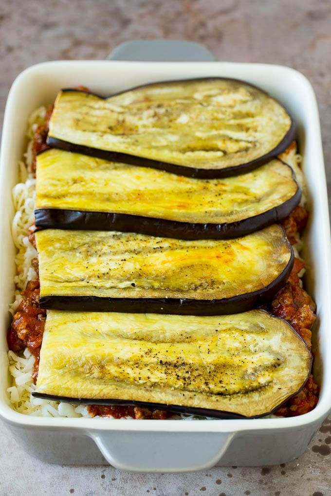 Layers of eggplant, sauce and cheese in a baking dish.