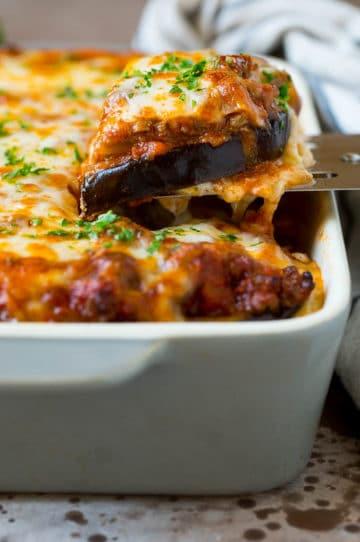 A spatula serving up a portion of eggplant lasagna.