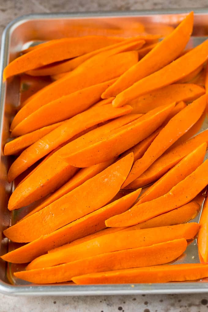 Cooked sweet potatoes on a sheet pan.