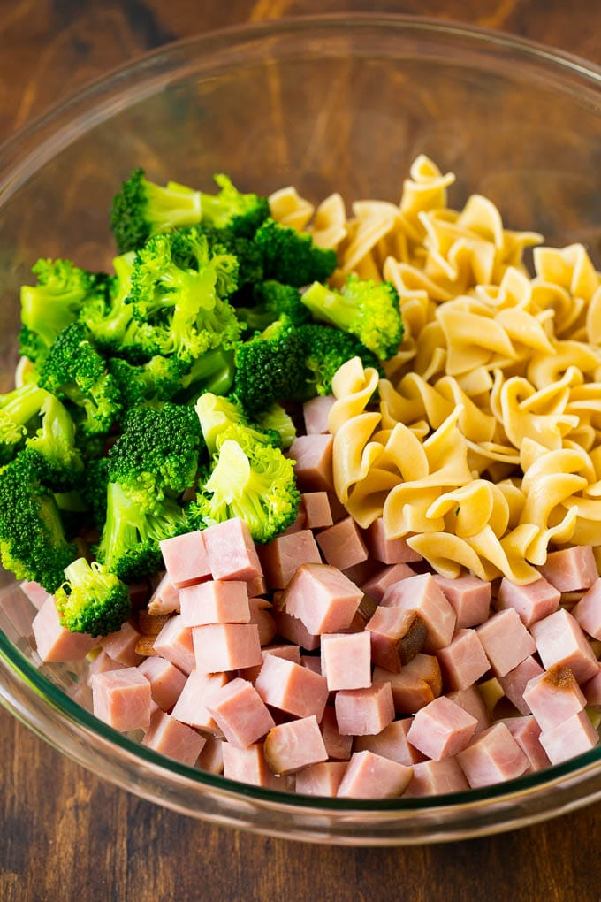 Diced ham, broccoli and egg noodles in a bowl.