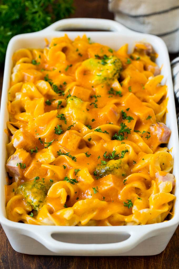 Ham casserole with egg noodles and broccoli, topped with melted cheese.