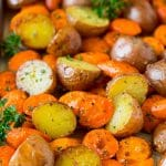 Roasted potatoes and carrots with garlic and fresh herbs.