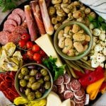 An antipasto platters with meats, cheeses, olives and vegetables.