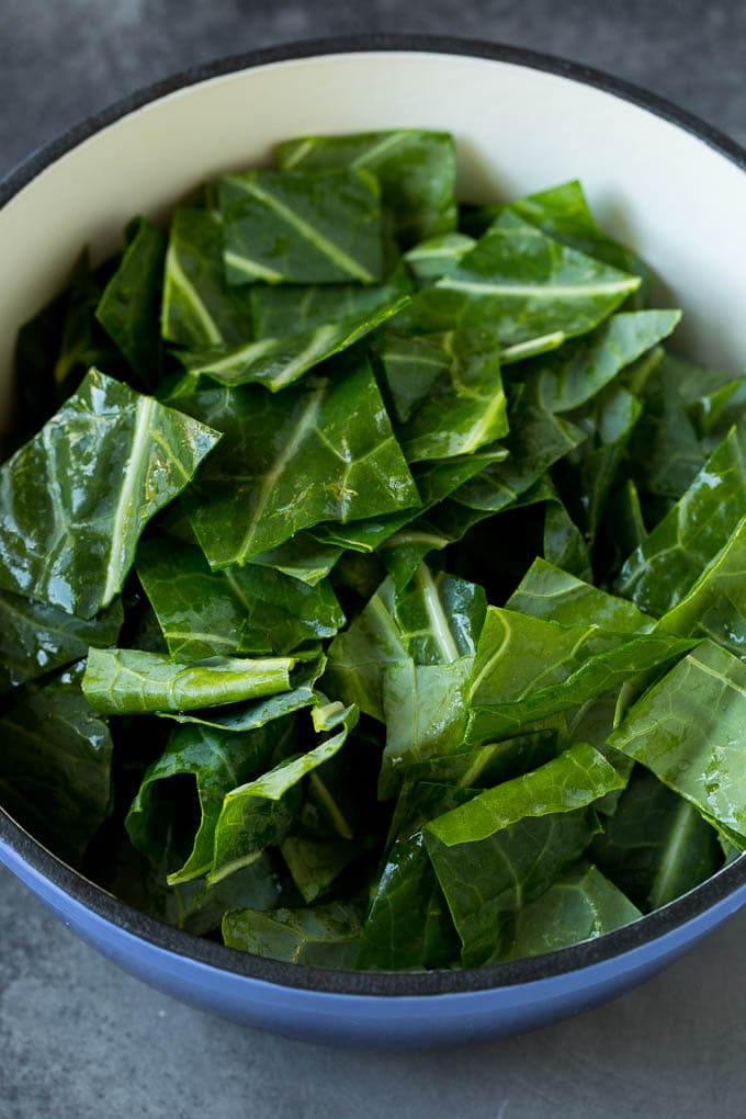 Raw chopped greens in a pot.