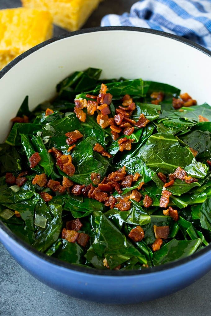 A pot of collard greens topped with crispy bacon.