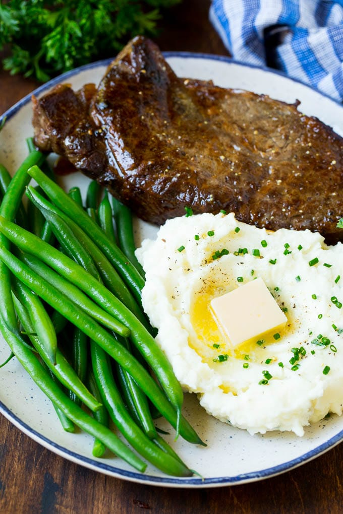 Cream cheese mashed potatoes served with steak and green beans.