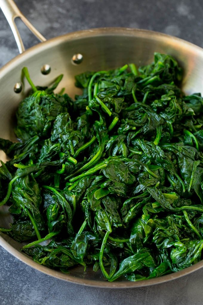 Cooked spinach in a pan.