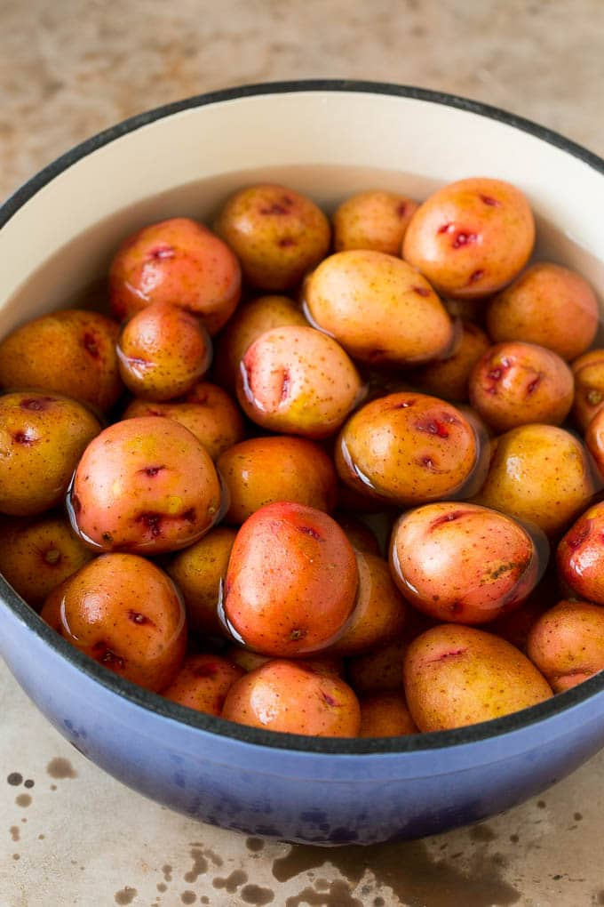 A pot of whole potatoes in boiling water.
