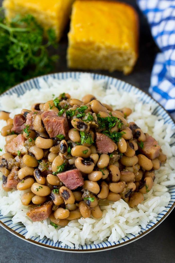 Hoppin' John served over steamed rice and garnished with parsley.