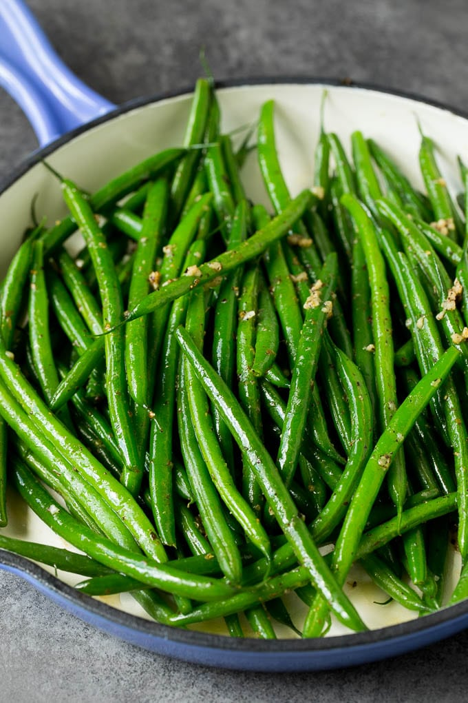 Cooked beans tossed with garlic and herbs.