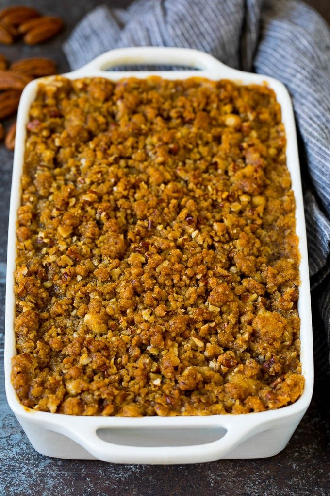 Sweet potato souffle in a casserole dish with a brown sugar topping.