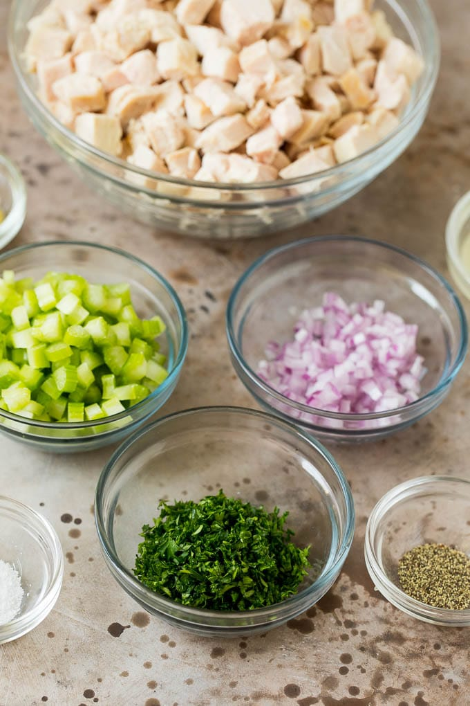Bowls of diced turkey, celery, onions and herbs.