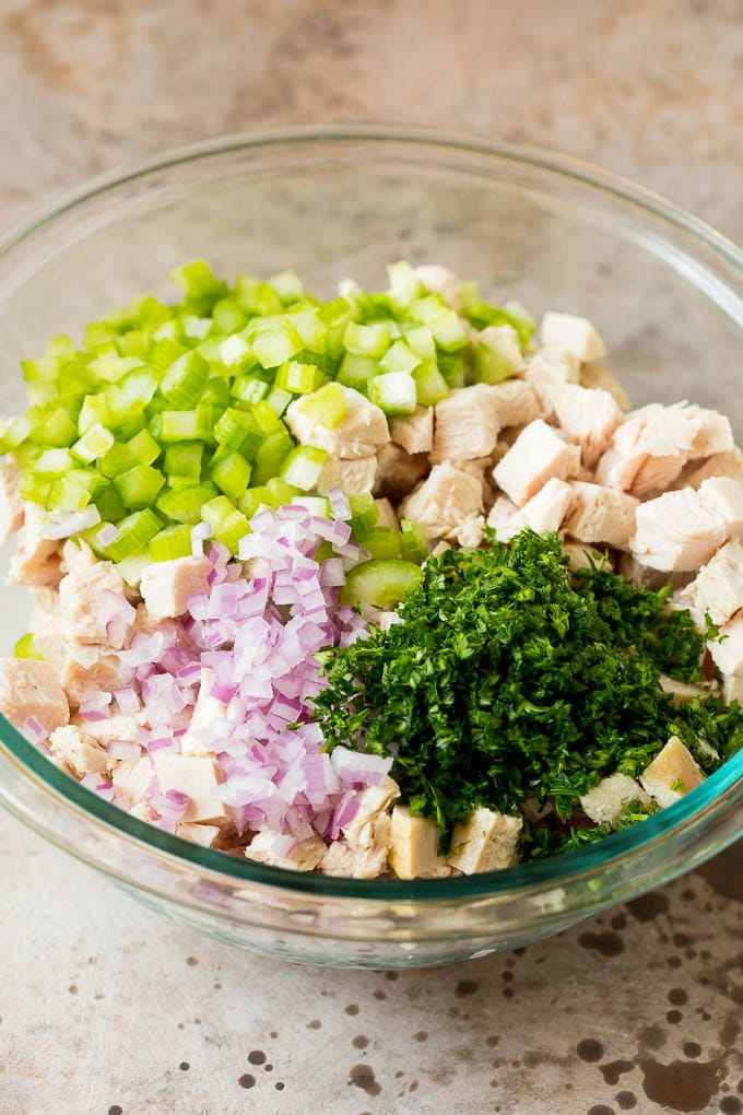 Turkey, vegetables and parsley in a bowl.