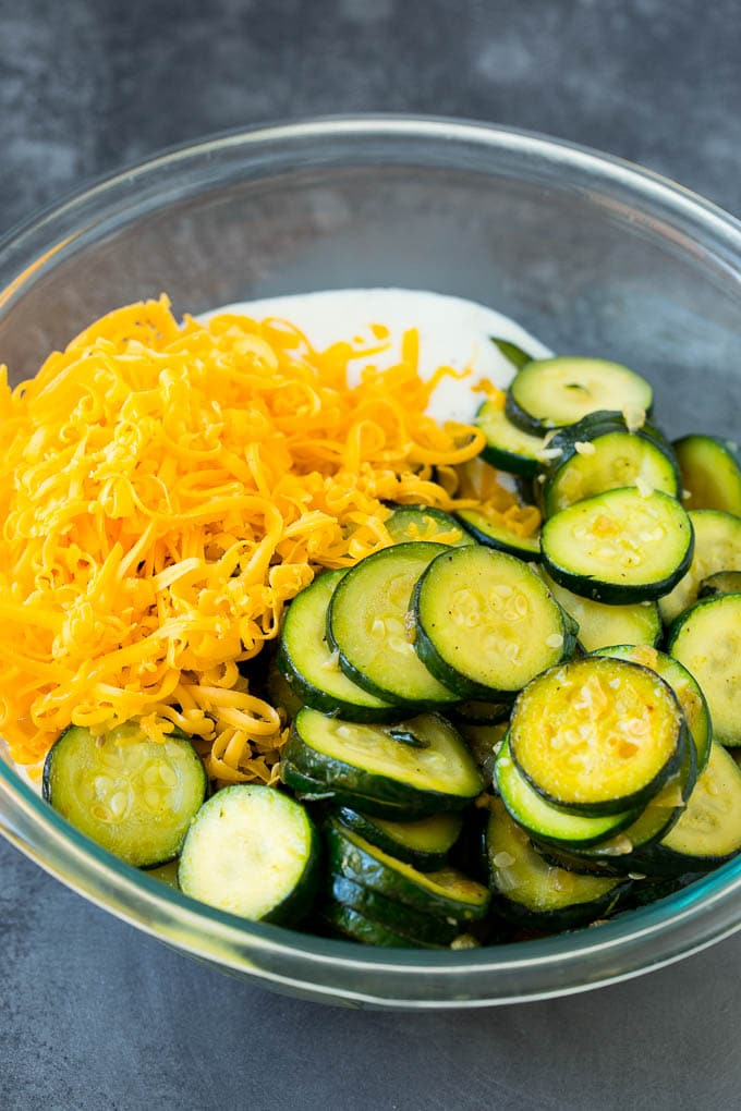 Zucchini, cheese and sauce in a bowl.