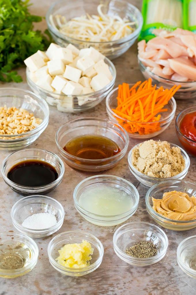 Bowls of ingredients including sauces, seasonings and vegetables.