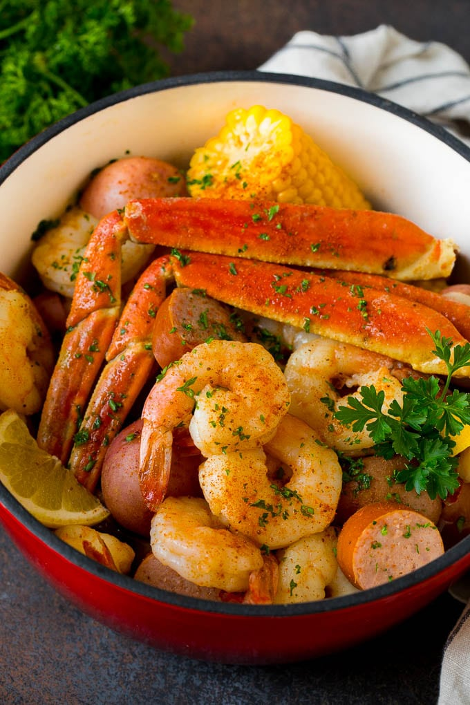 A pot of Low Country Boil with shrimp, crab and vegetables.