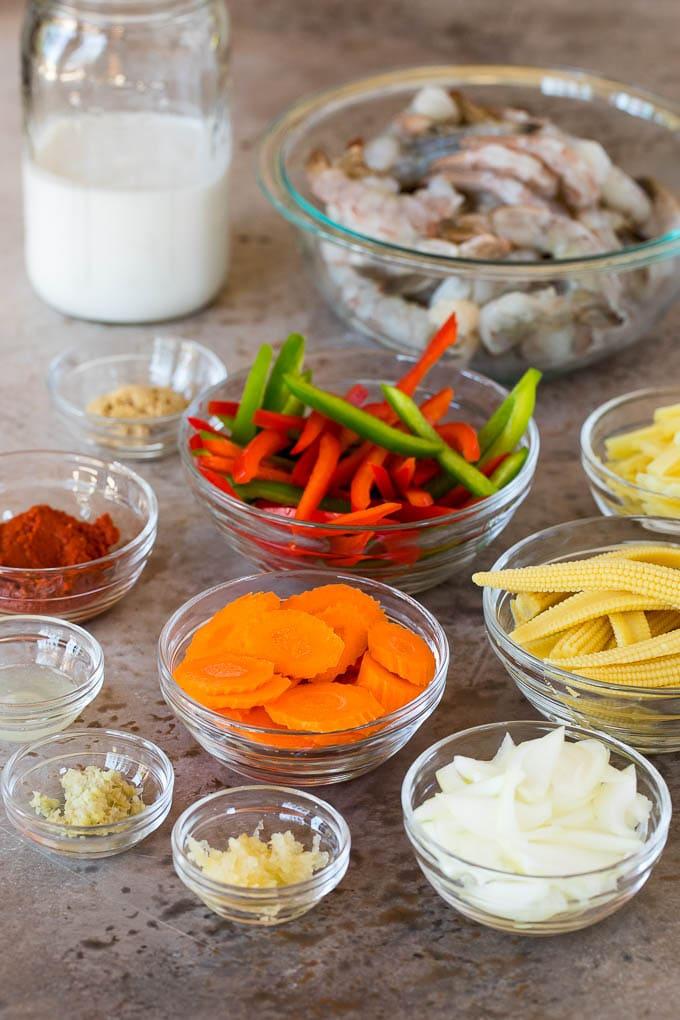 Bowls of ingredients including shrimp and assorted vegetables.