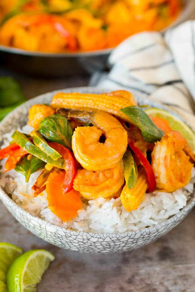 A bowl of shrimp curry served over rice.