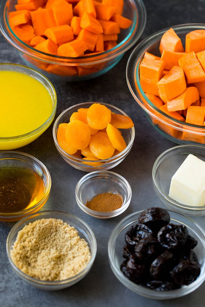 Bowls of vegetables, dried fruit, brown sugar and cinnamon.