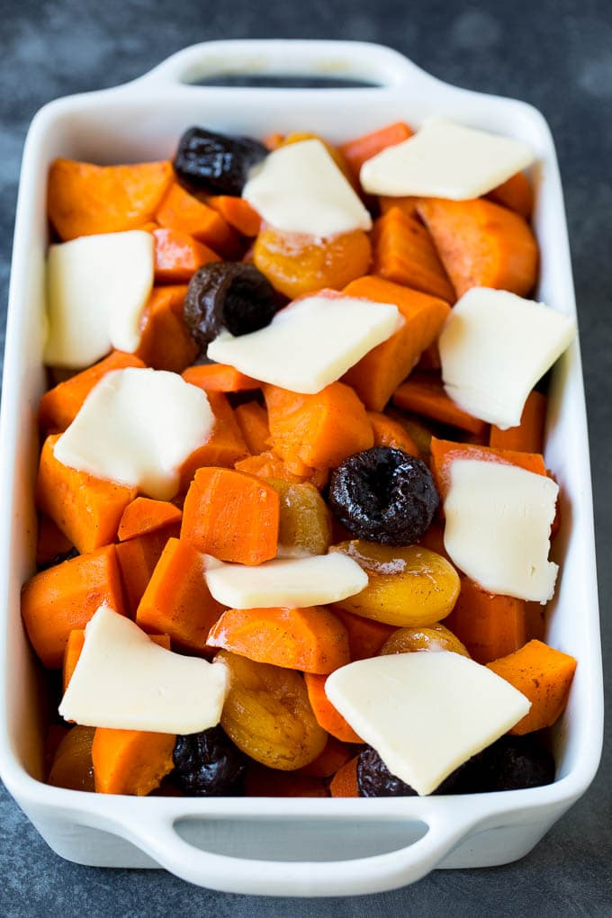 Thinly sliced butter on top of dried fruit and sweet potatoes.