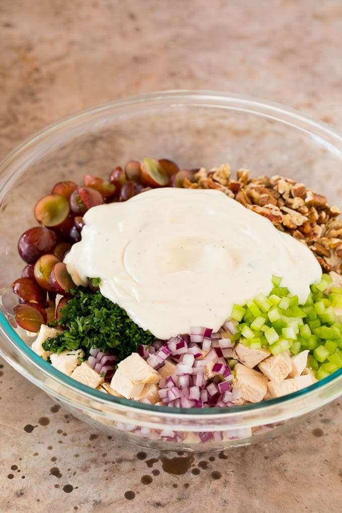 Creamy dressing poured over diced chicken and vegetables.