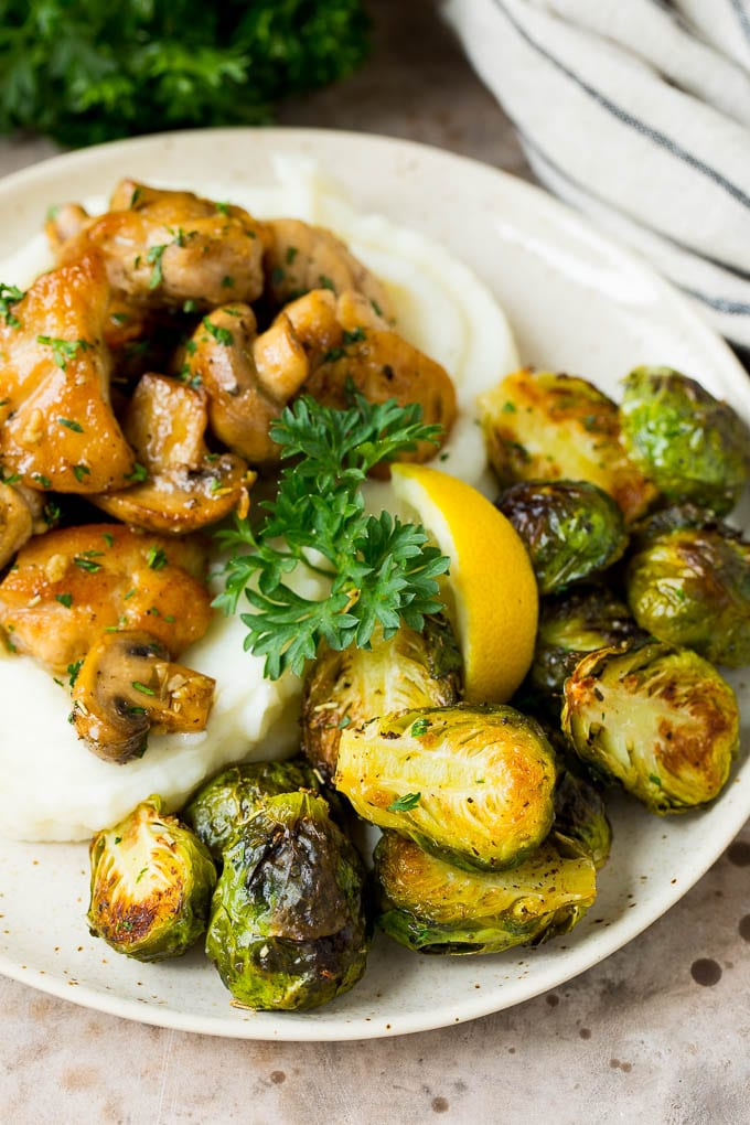 Crispy Brussels sprouts served with mashed potatoes and garlic chicken.