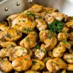 Garlic butter chicken and mushrooms topped with parsley.